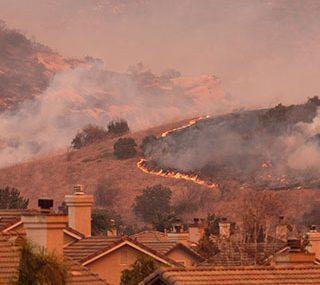 Wildfire burning near houses